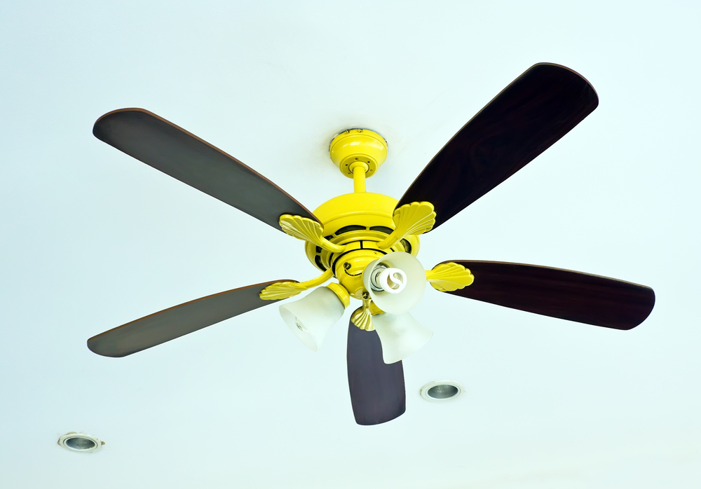 black fan with gold fixtures in a home